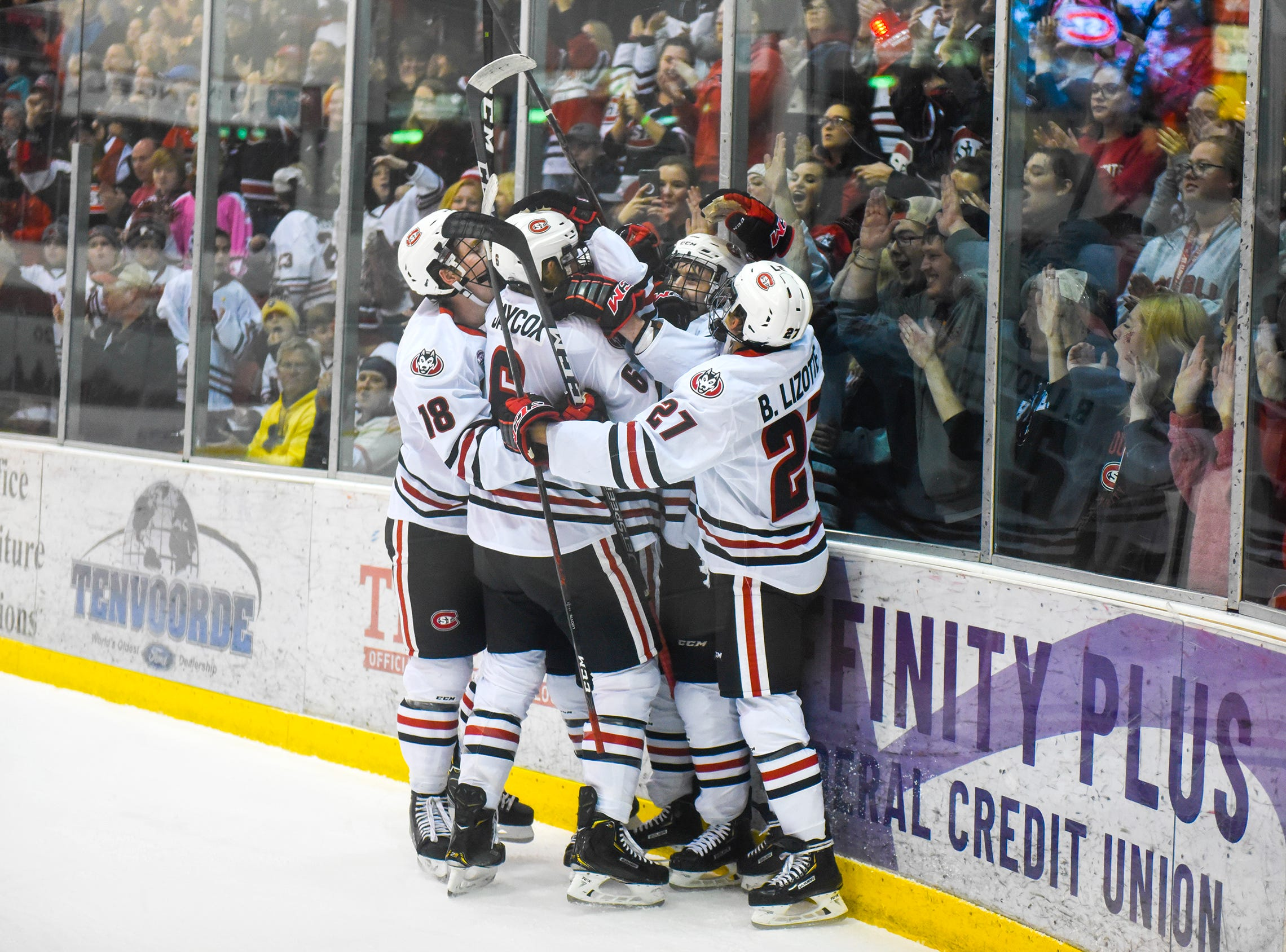 St. Cloud State players celebrate a goal during the first period of the  Saturday, Oct. 20, game against Northern Michigan at the Herb Brooks National Hockey Center in St. Cloud.