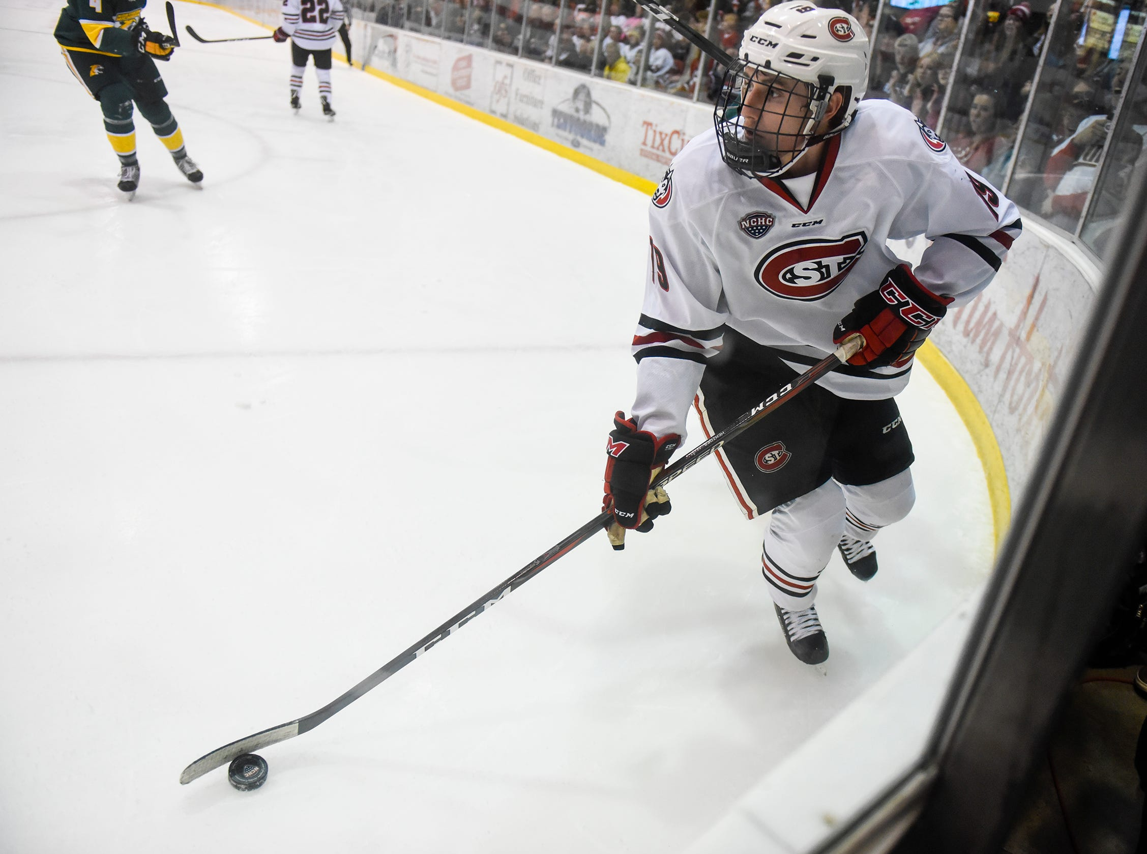 St. Cloud State's Sam Hentges skates with the puck along the boards during the Saturday, Oct. 20, game against Northern Michigan at the Herb Brooks National Hockey Center in St. Cloud.