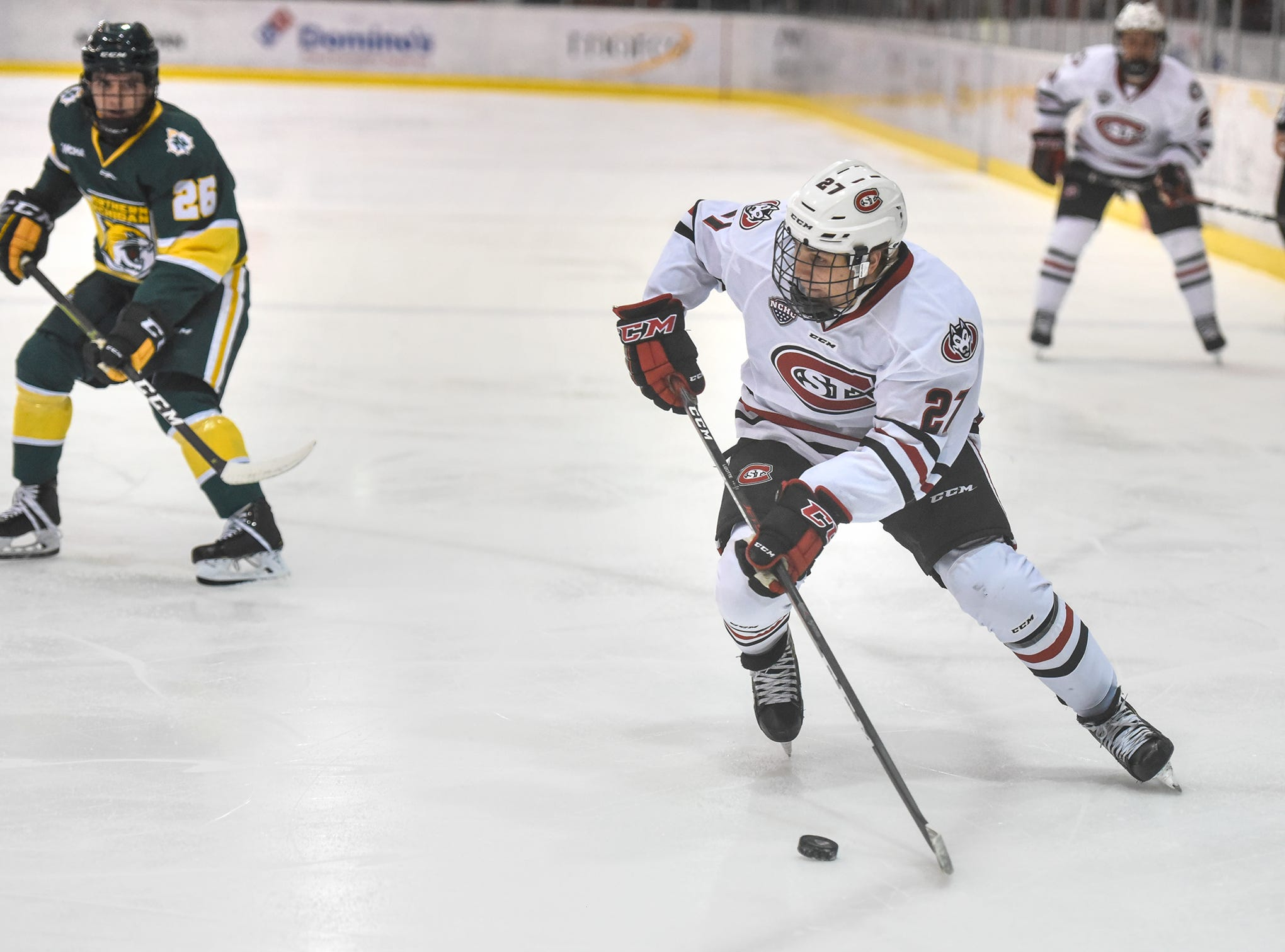 Jake Wahlin skates with the puck during the Saturday, Oct. 20, game against Northern Michigan at the Herb Brooks National Hockey Center in St. Cloud.