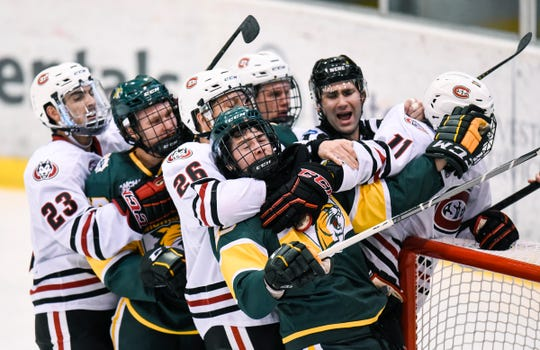 Players clash near the St. Cloud State goal during the Saturday, Oct. 20, game against Northern Michigan at the Herb Brooks National Hockey Center in St. Cloud.