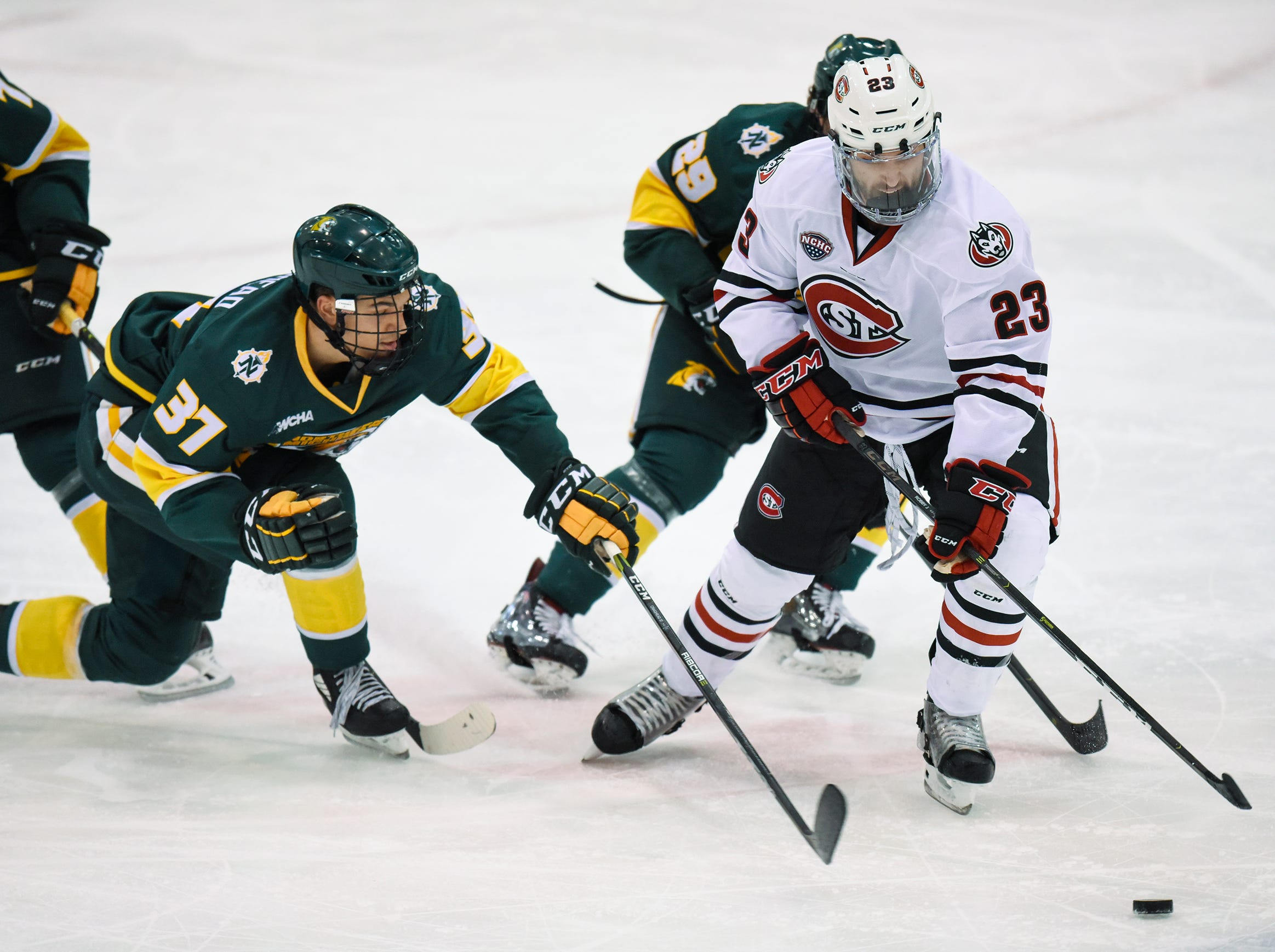 St. Cloud State's Robby Jackson tries to control the puck during the Saturday, Oct. 20, game against Northern Michigan at the Herb Brooks National Hockey Center in St. Cloud.