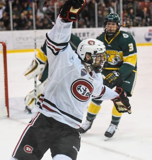 St. Cloud State's Patrick Newell celebrates a goal during the first period of the Saturday, Oct. 20, game against Northern Michigan at the Herb Brooks National Hockey Center in St. Cloud.