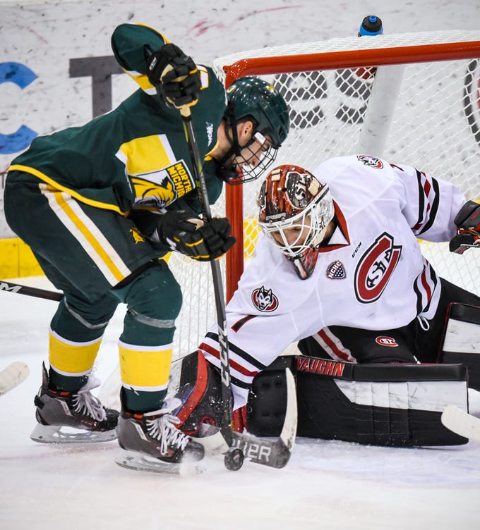 St. Cloud State goaltender Jeff Smith blocks a shot by Northern Michigan's Luke Voltin during the second period of the Saturday, Oct. 20, game at the Herb Brooks National Hockey Center in St. Cloud.