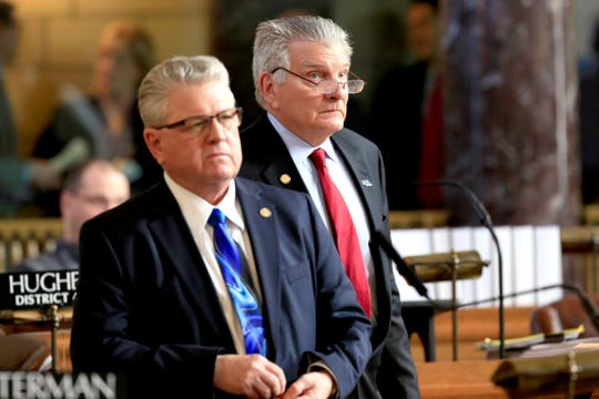 In this March 13, 2018 photo, Nebraska state Sens. John Stinner of Gering, right, and Mark Kolterman of Seward follow debate in the Legislative Chamber in Lincoln, Neb. Faced with the possibility that Neb. voters might approve a ballot measure expanding Medicaid, Stinner says he does not want to be insensitive to people in that Medicaid expansion group, but he does not think it is sustainable. Kolterman does not believe anybody (in the Legislature) who voted against extending Medicaid is really opposed to helping people, but wonders how the state is going to pay for it. (AP Photo/Nati Harnik)
