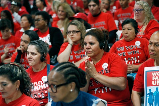 In this Oct. 17, 2018, photo, members of the Culinary Union listen to Democratic candidates during an event at the union hall in Las Vegas. Unite Here, parent organization of the Culinary Union, announced it will not endorse a Democratic primary candidate. Culinary has not said whether it will endorse.