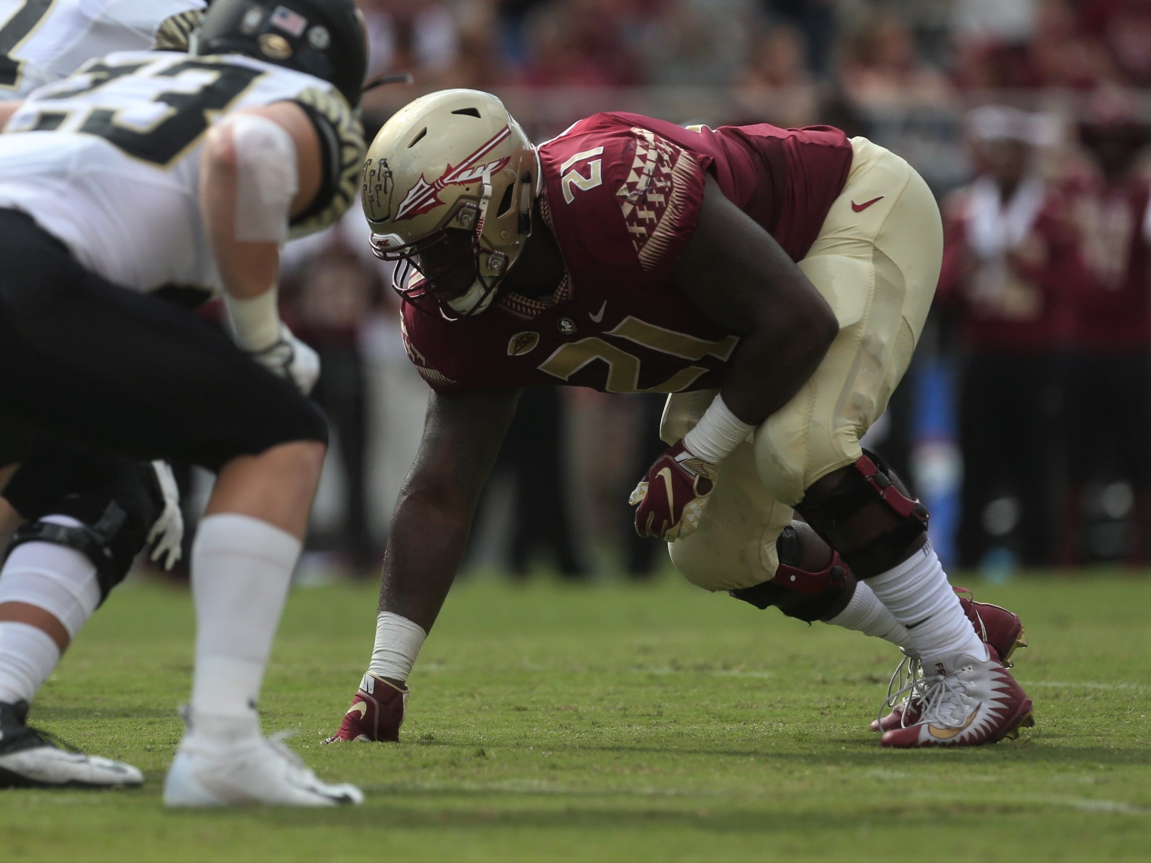 Florida State defensive tackle Marvin Wilson prepares for a Wake Forest snap during a game at Doak Campbell Stadium on Saturday, Oct. 20, 2018.