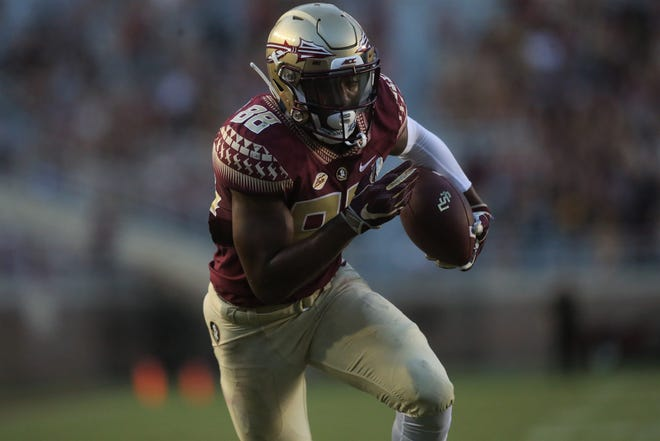 Florida State wide receiver Tre'Shaun Harrison turns a short pass into a juking  21-yard touchdown against Wake Forest during a game at Doak Campbell Stadium on Saturday, Oct. 20, 2018.