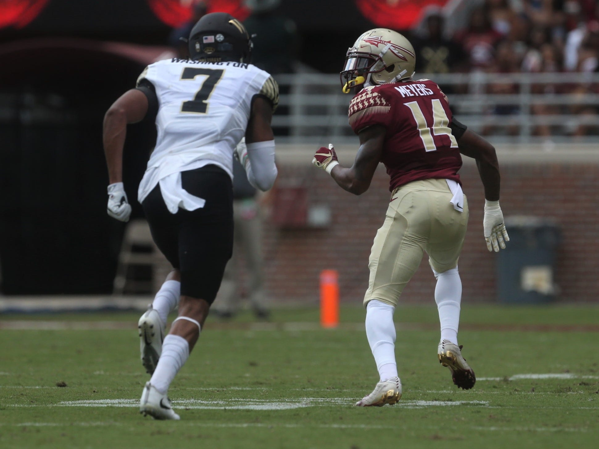 Florida State defensive back Kyle Meyers runs back in coverage of Wake Forest receiver Scott Washington during a game at Doak Campbell Stadium on Saturday, Oct. 20, 2018.