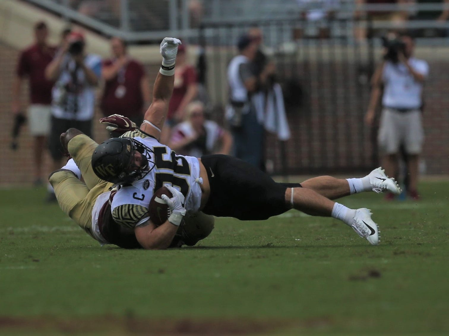 Wake Forest running back Cade Carney is taken down by a Florida State defender in space during a game at Doak Campbell Stadium on Saturday, Oct. 20, 2018.