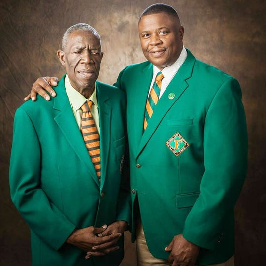 Former FAMU athletics director Roosevelt Wilson (left) poses with his son, Vaughn.