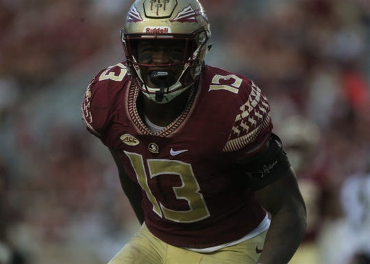 Florida State defensive end Joshua Kaindoh celebrates a sack against Wake Forest during a game at Doak Campbell Stadium on Saturday, Oct. 20, 2018.