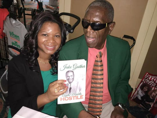 """FAMU sports legend Roosevelt Wilson poses with Alonda Thomas. Wilson authored the book titled """"Agile, Mobile, Hostile: The Biography of Alonzo S. Jake Gaither."""""""
