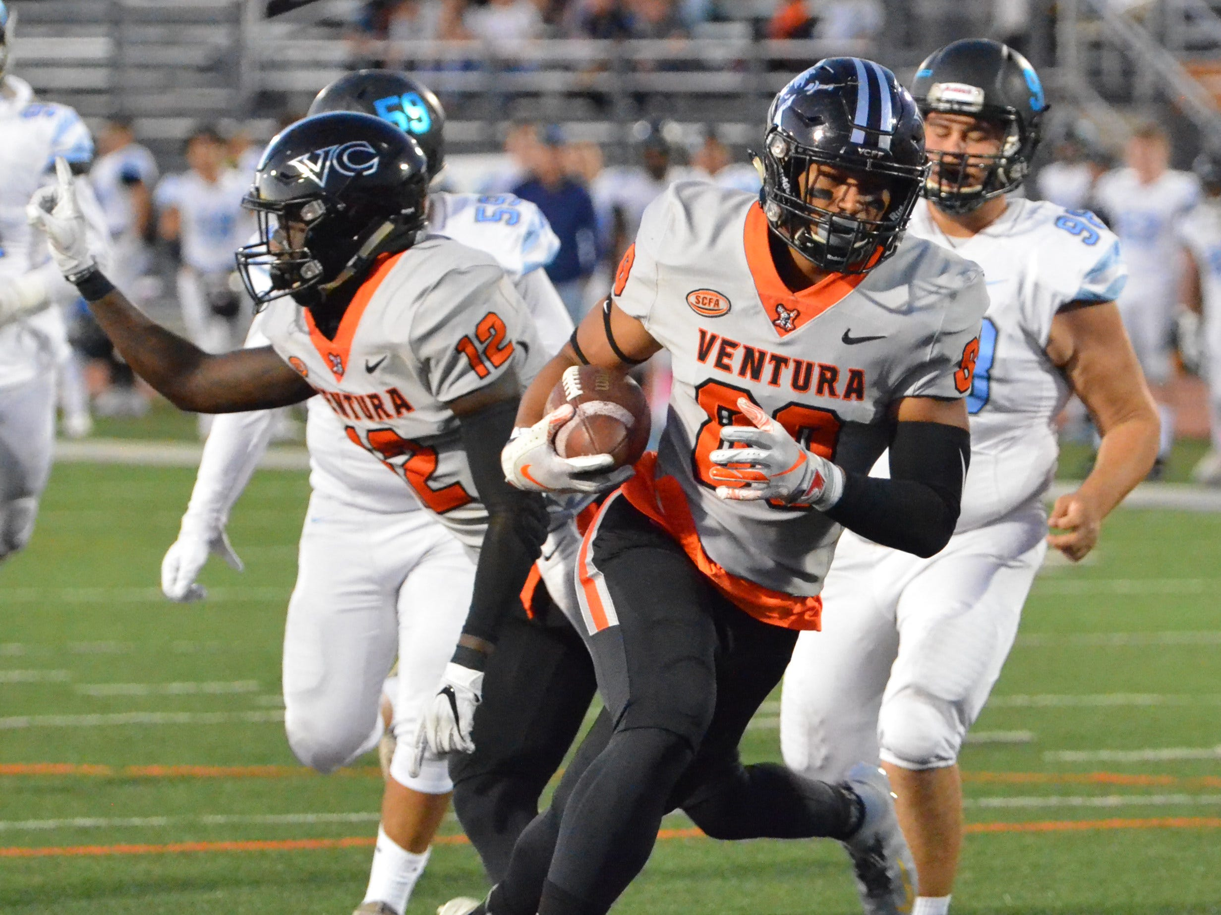 Ventura College's Jared Thomsen returns a blocked punt for a touchdown in the 51st Citrus Cup game on Saturday night at the VC Sportsplex. VC won 62-7.