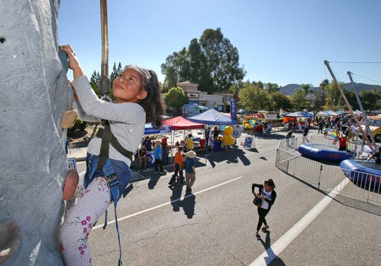 In this file photo, Eunice Narin-Ordonez, of Thousand Oaks scales a climbing wall at the 2018 street fair Thousand Oaks, which hosted by the Rotary Club of Thousand Oaks.