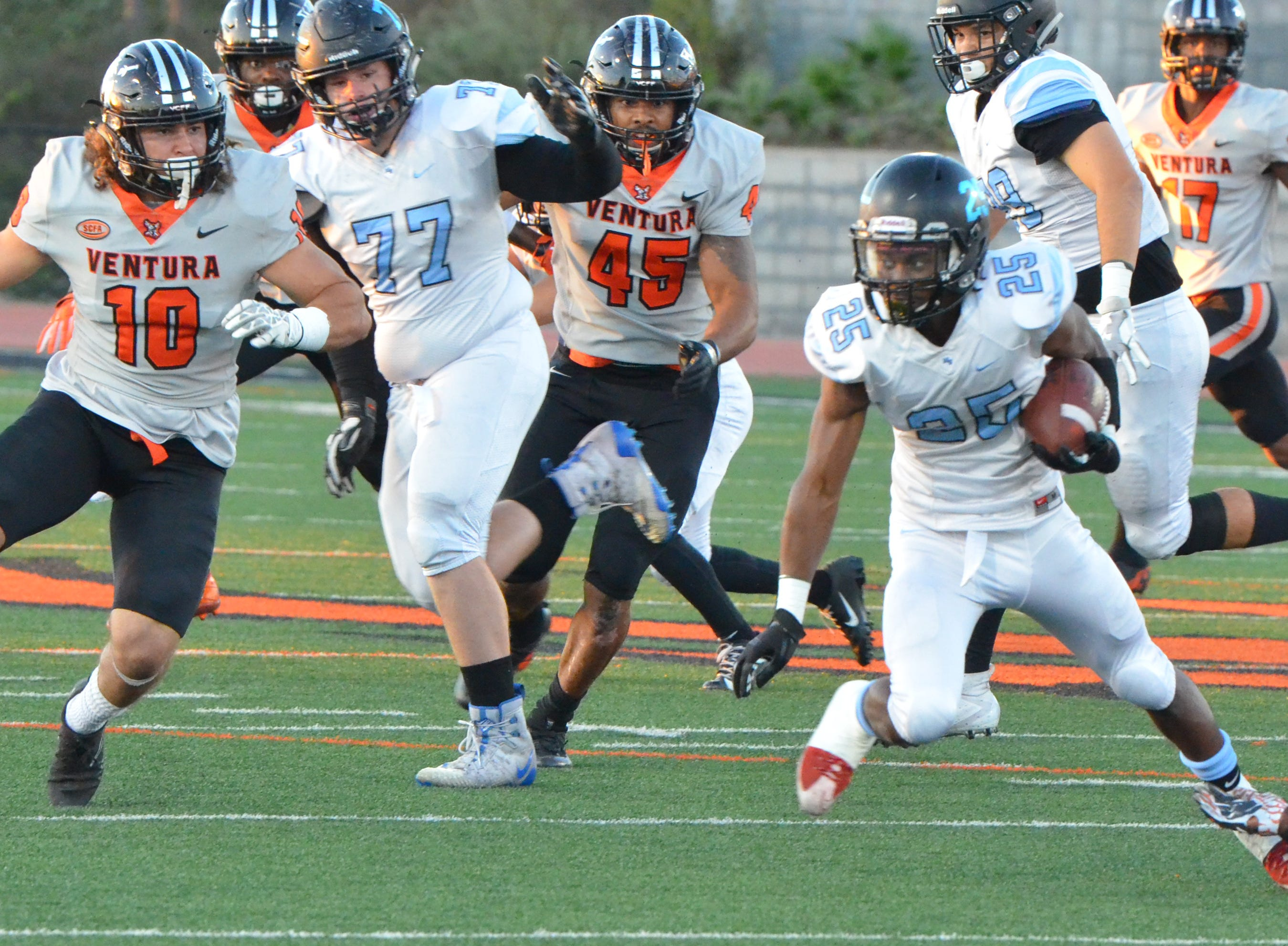 Moorpark College running back Brandon Archibald looks for daylight in the 51st Citrus Cup game on Saturday night at the VC Sportsplex. VC won 62-7.