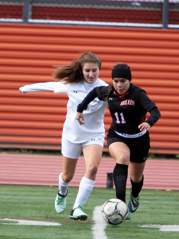 Mamaroneck's Katerina Orfanos and White Plains' Julia Mancini fight for possession of the ball during a Section 1 first round girls soccer playoff game between Mamaroneck and White Plains on October 21st, 2018 at White Plains High School. Mamaroneck won 2-1 in double-overtime.