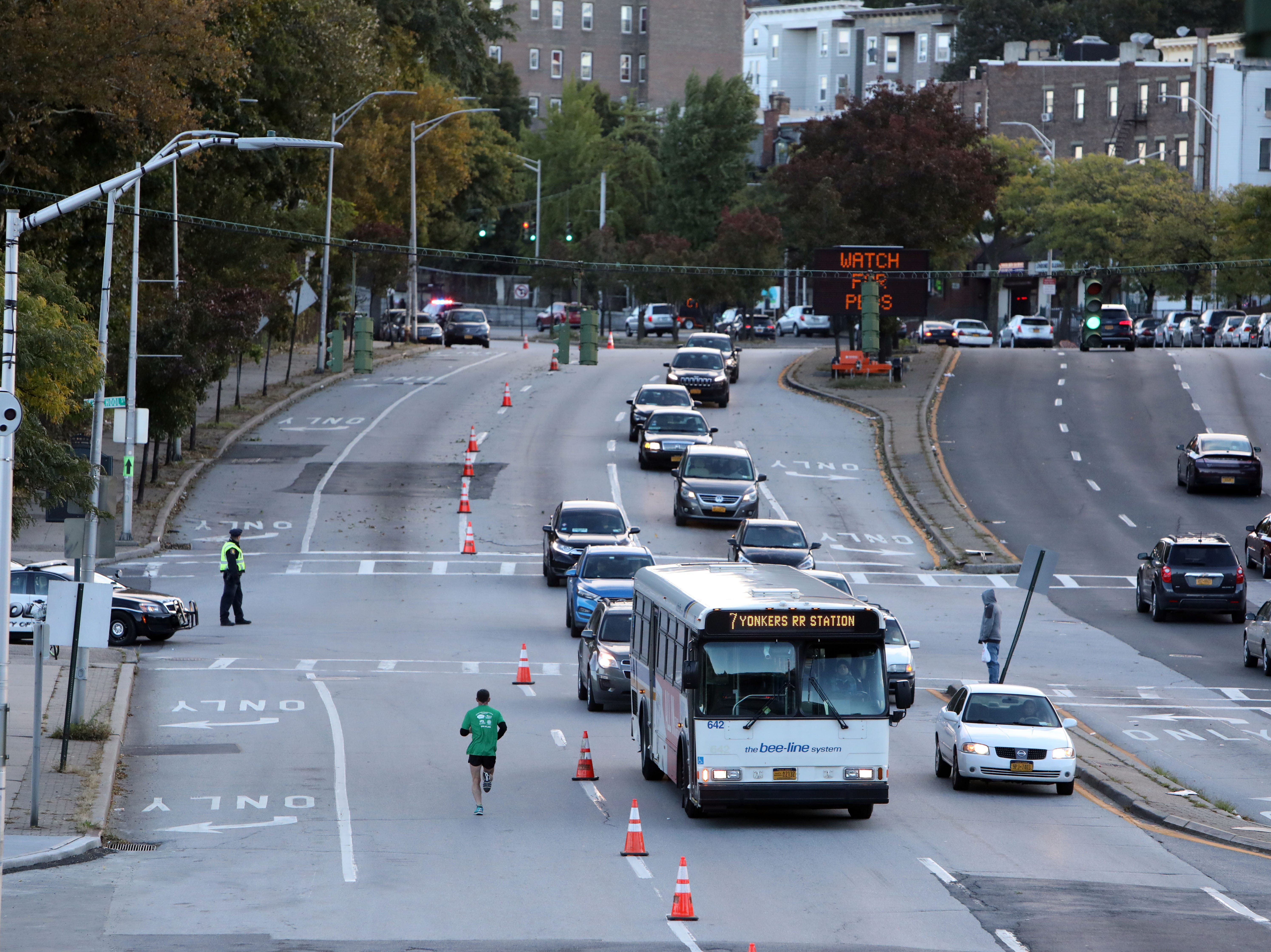 A lone runner makes his way up Nepperhan Avenue during the Yonkers Marathon, half marathon and 5k, which started at Yonkers Riverfront Library, Oct. 21, 2018.