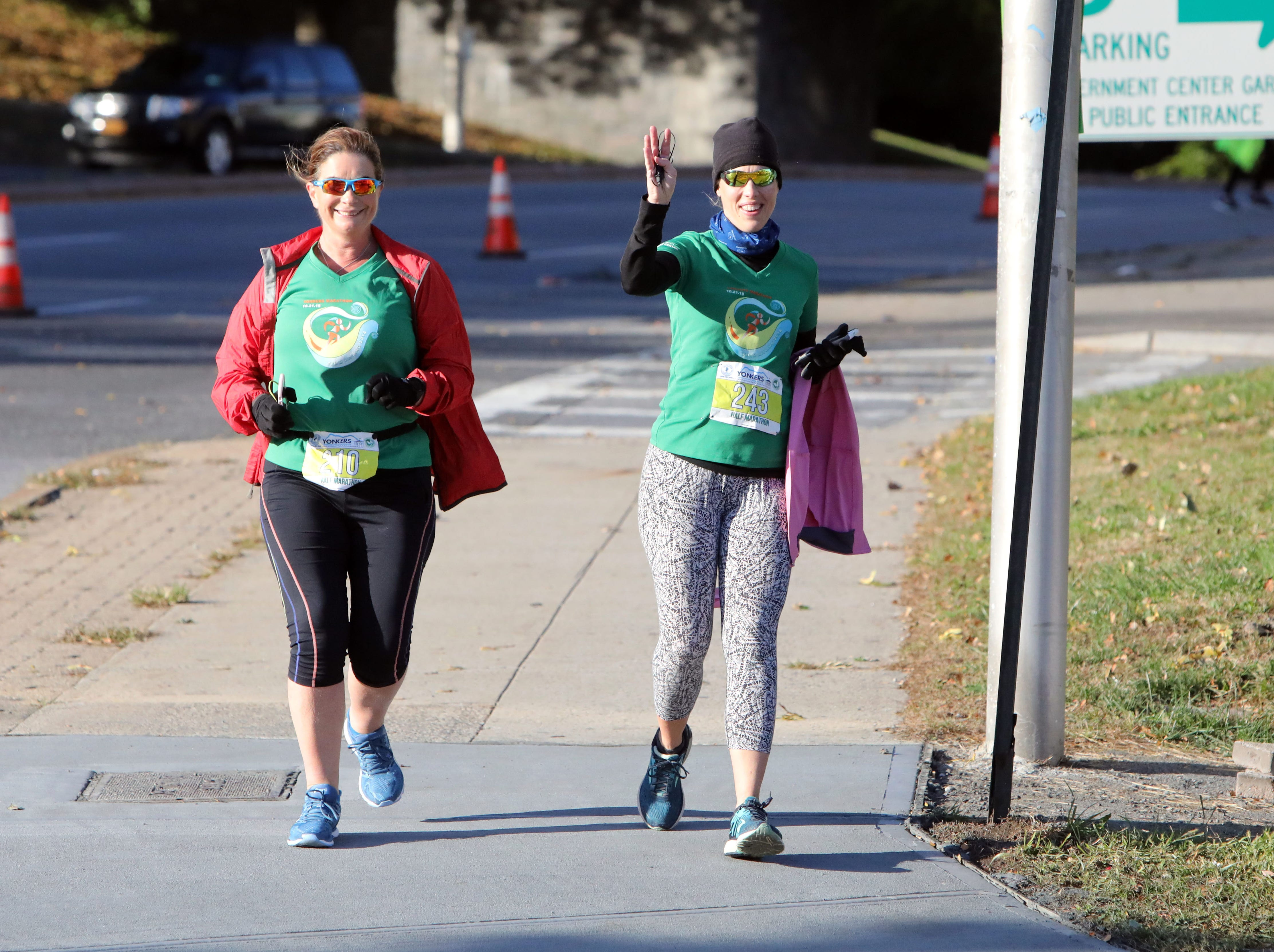 Mary Quinn - Mc Aleer, left, and Wendy O'Reilly, both of Pearl River, run with Team Aisling in the Yonkers Marathon, half marathon and 5k, Oct. 21, 2018.