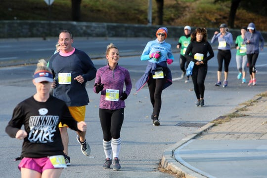 Runners make their way through the hills on Nepperhan Avenue during the Yonkers Marathon, half marathon and 5k, which started at Yonkers Riverfront Library, Oct. 21, 2018.