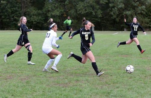 Nanuet's Tara Slinn, left, Caroline Moran, center, Morgan Lowther in action against Alexa Jindal of Byram Hills in the first round of girls soccer playoffs at Nanuet High School, Oct. 21, 2018. Nanuet went on to win, 2-1.