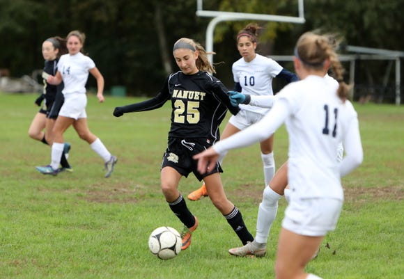 Abigail Daley, left, of Nanuet in action against Byram Hills during the first round of girls soccer playoffs at Nanuet High School, Oct. 21, 2018. Nanuet went on to win, 2-1.
