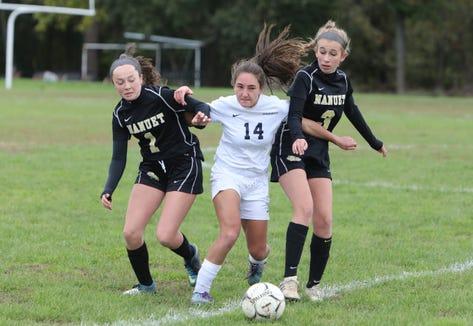 Byram Hills' Kallie Hoffman fights for a ball between Nanuet defenders during a Section 1 Class A first round girls soccer game at Nanuet High School Oct. 21, 2018.