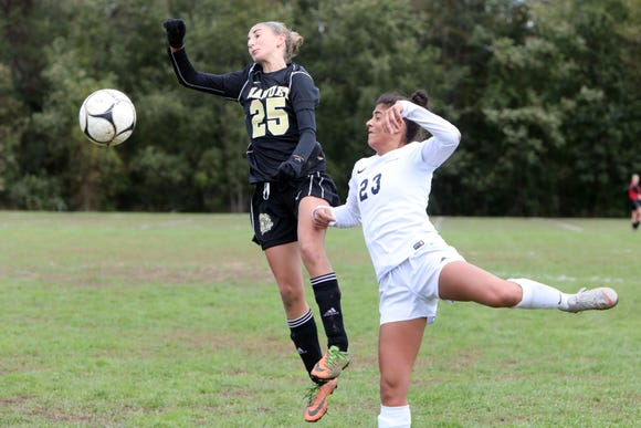 Abigail Daley, left, of Nanuet and Alexa Jindal of Byram Hills in action during the first round of girls soccer playoffs at Nanuet High School, Oct. 21, 2018. Nanuet went on to win, 2-1.