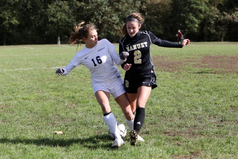 Reese Ertel, left, of Byram Hills and Ciara Saxton of Nanuet fight for possession of the ball in the first round of girls soccer playoffs at Nanuet High School, Oct. 21, 2018. Nanuet went on to win, 2-1.