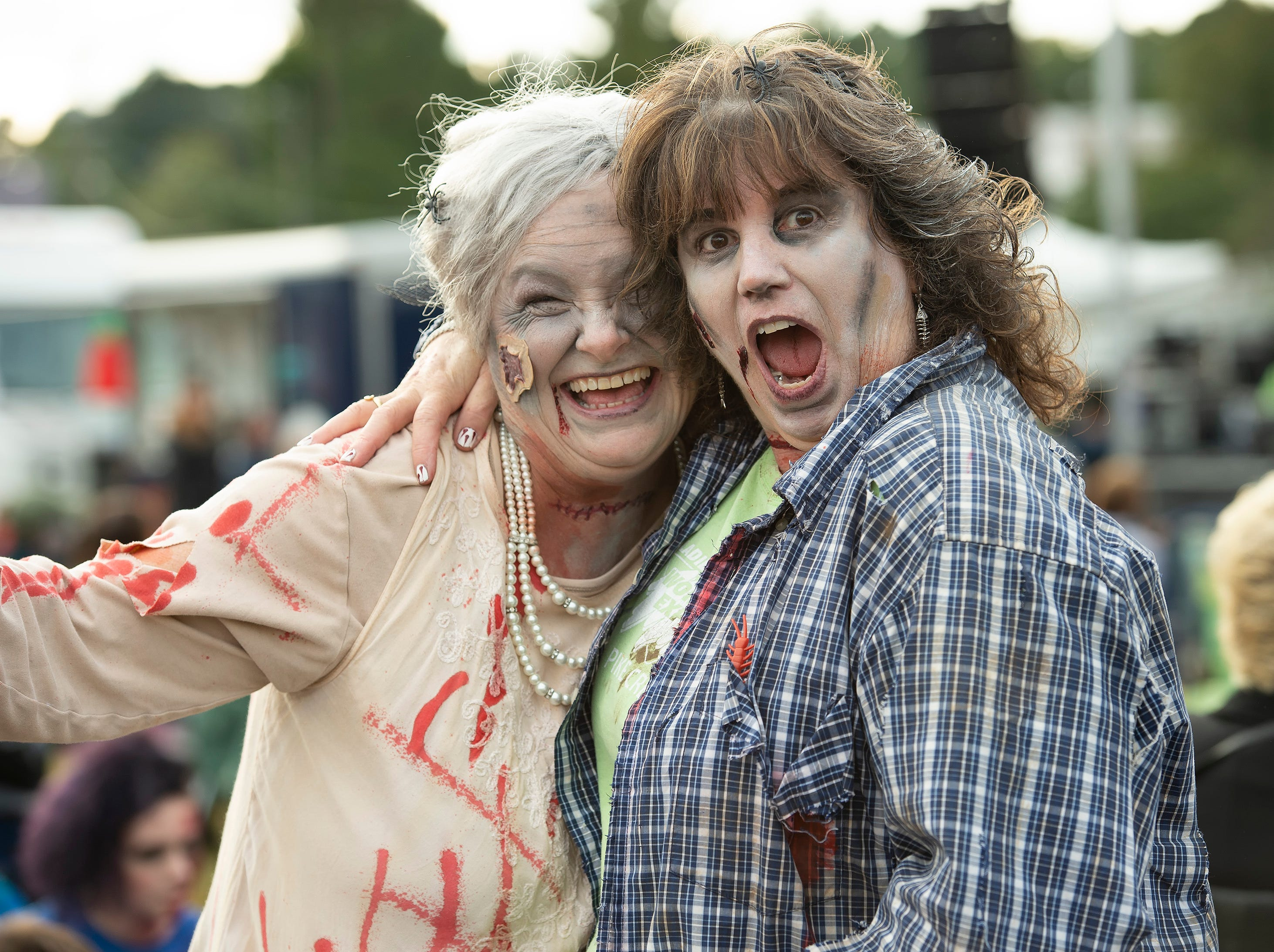 Fran Kiser, left, of Milton and Cindy Gray of Newark pose for a photo at Milton Zombie Fest.