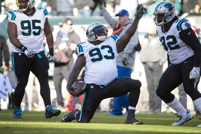 Carolina defensive tackle Kyle Love celebrates after recovering Carson Wentz's fumble on 4th-and-2 with less than a minute left to clinch the Eagles' 21-17 loss Sunday.