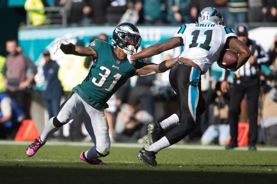 Eagles Jalen Mills (31) reaches out to stop Carolina's Torrey Smith Sunday at Lincoln Financial Field.