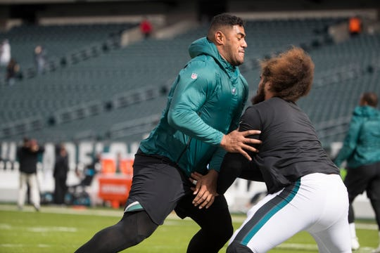 Eagles' Jordan Mailata warms up ahead of the Eagles clash against the Panthers.