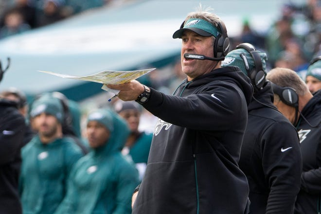 Eagles head coach Doug Pederson gives instructions to his team Sunday at Lincoln Financial Field.
