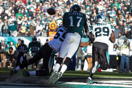 Carolina's Mike Adams (29) breaks up a play in the end zone Sunday at Lincoln Financial Field.