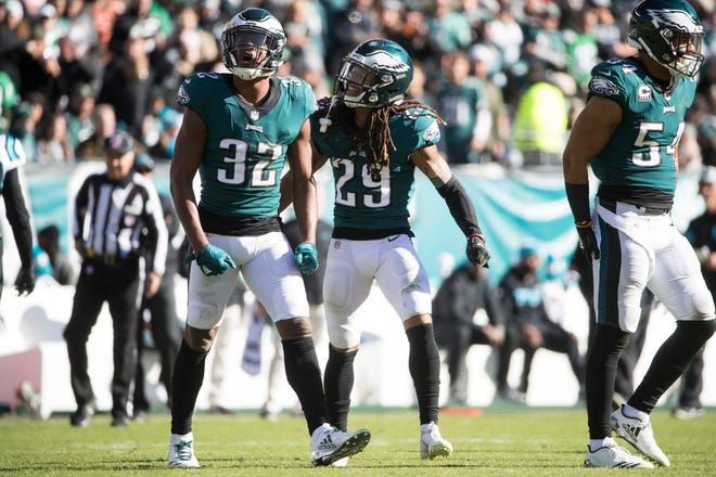 Eagles defensive back Rasul Douglas (32) celebrates a stop with Avonte Maddox (29). Douglas is expected to start in place of the injured Jalen Mills on Sunday.