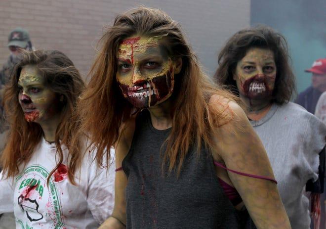 Zombies crawl through downtown Wichita Falls Saturday, Oct. 20, 2018, in the Downtown Wichita Falls Development, Inc Zombie Crawl.