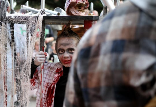 Brody Staelens takes part in the Downtown Wichita Falls Development, Inc Zombie Crawl Saturday, Oct. 20, 2018, around downtown Wichita Falls.