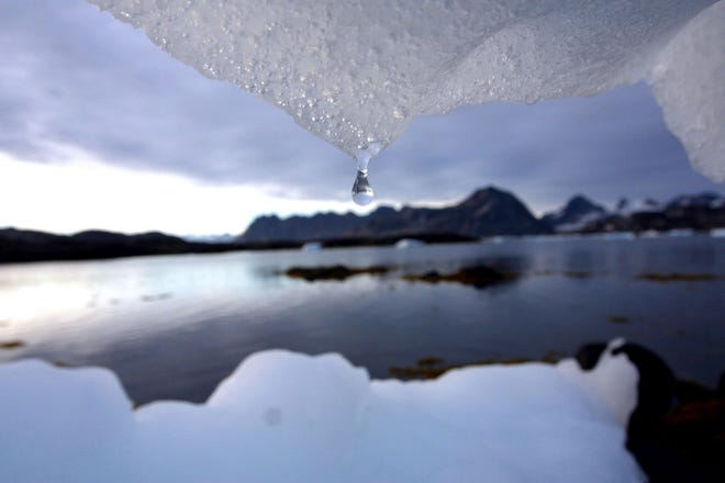 Iceberg melts in Kulusuk, Greenland near the Arctic Circle,  Aug, 16, 2005.
