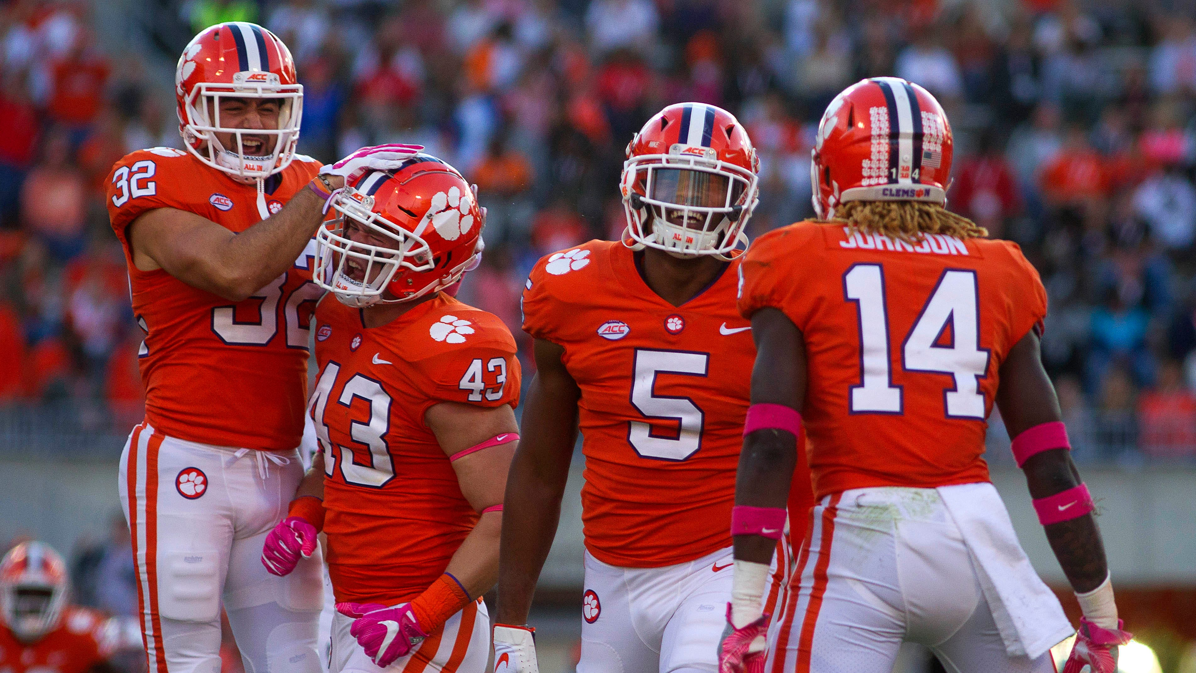 Safety Kyle Cote (32), linebacker Chad Smith (43), linebacker Shaq Smith (5), and safety Denzel Johnson (14) celebrate during another win for unbeaten Clemson.