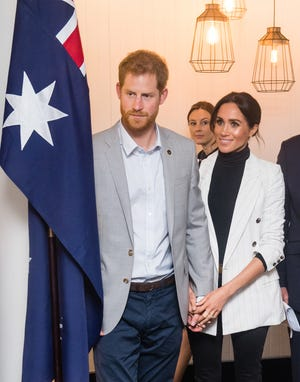 Prince Harry and Duchess Meghan attend a reception hosted by the Prime Minister of Australia at the Pavilion Restaurant on Oct. 21, 2018, in Sydney.