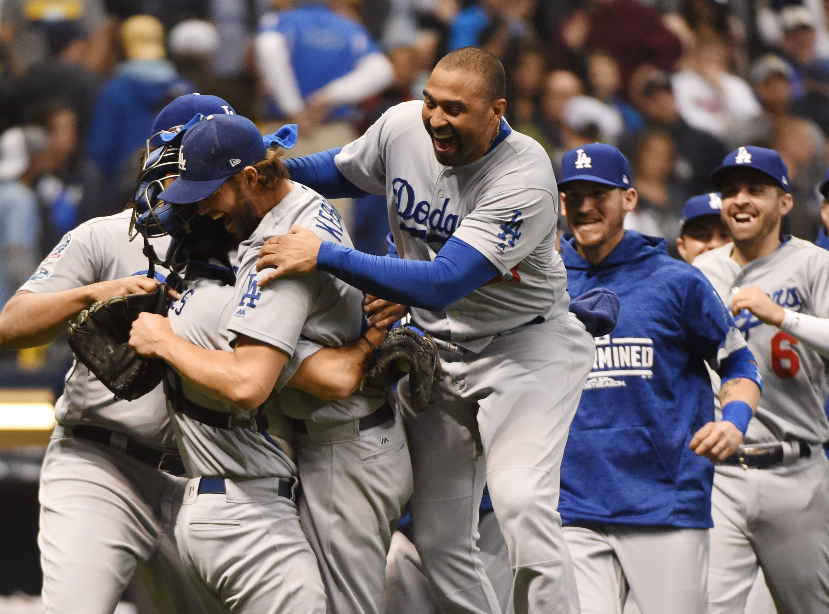 NLCS Game 7: Dodgers players celebrate the final out of the 5-1 win.