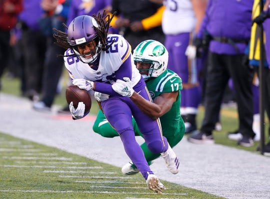 Minnesota Vikings cornerback Trae Waynes (26) is tackled by New York Jets wide receiver Charone Peake (17) after intercepting a pass during the second half at MetLife Stadium.