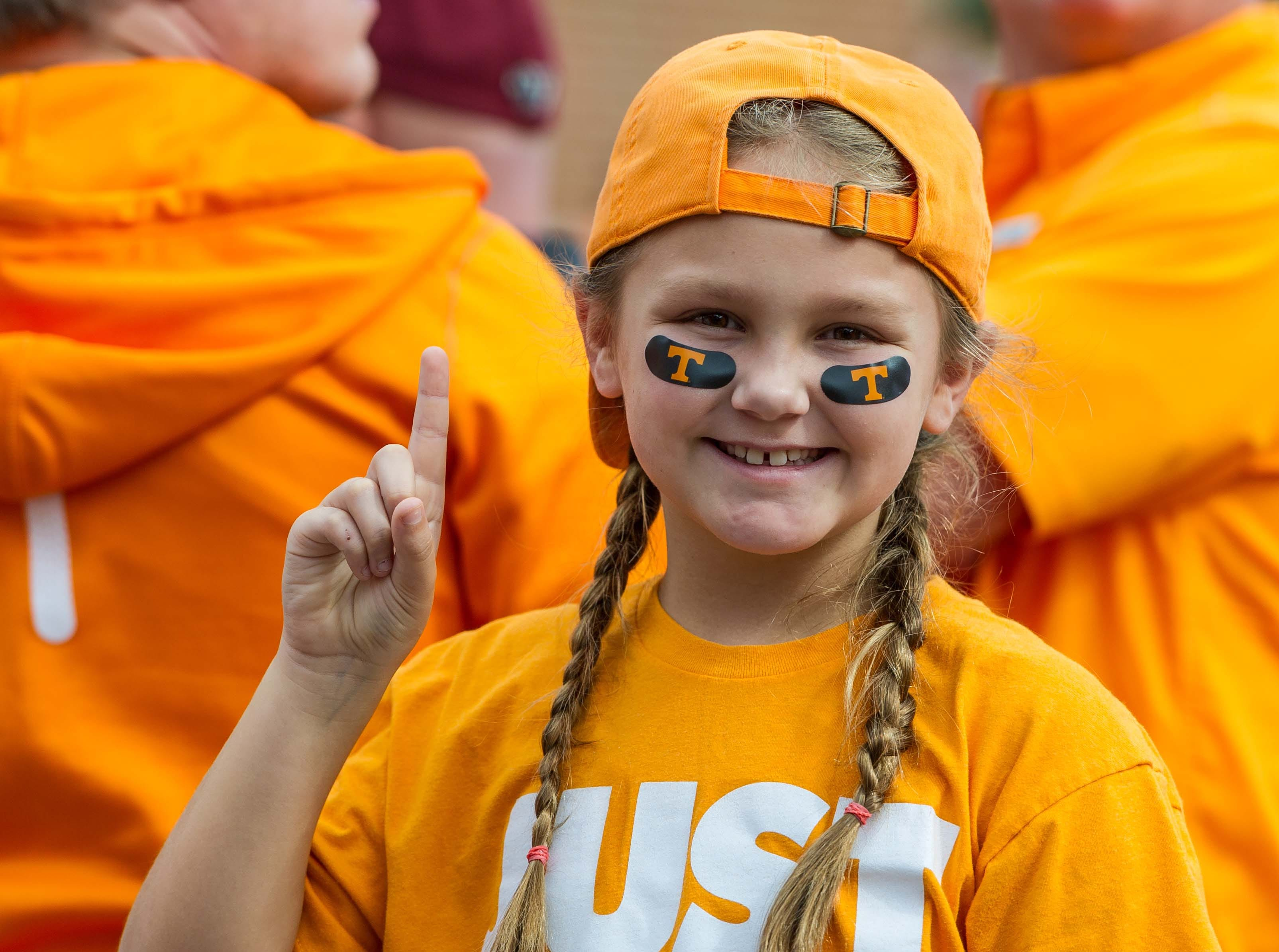 Week 8: Tennessee Volunteers fan Sydney Wilhite poses for a picture before the game against the Alabama Crimson Tide at Neyland Stadium.