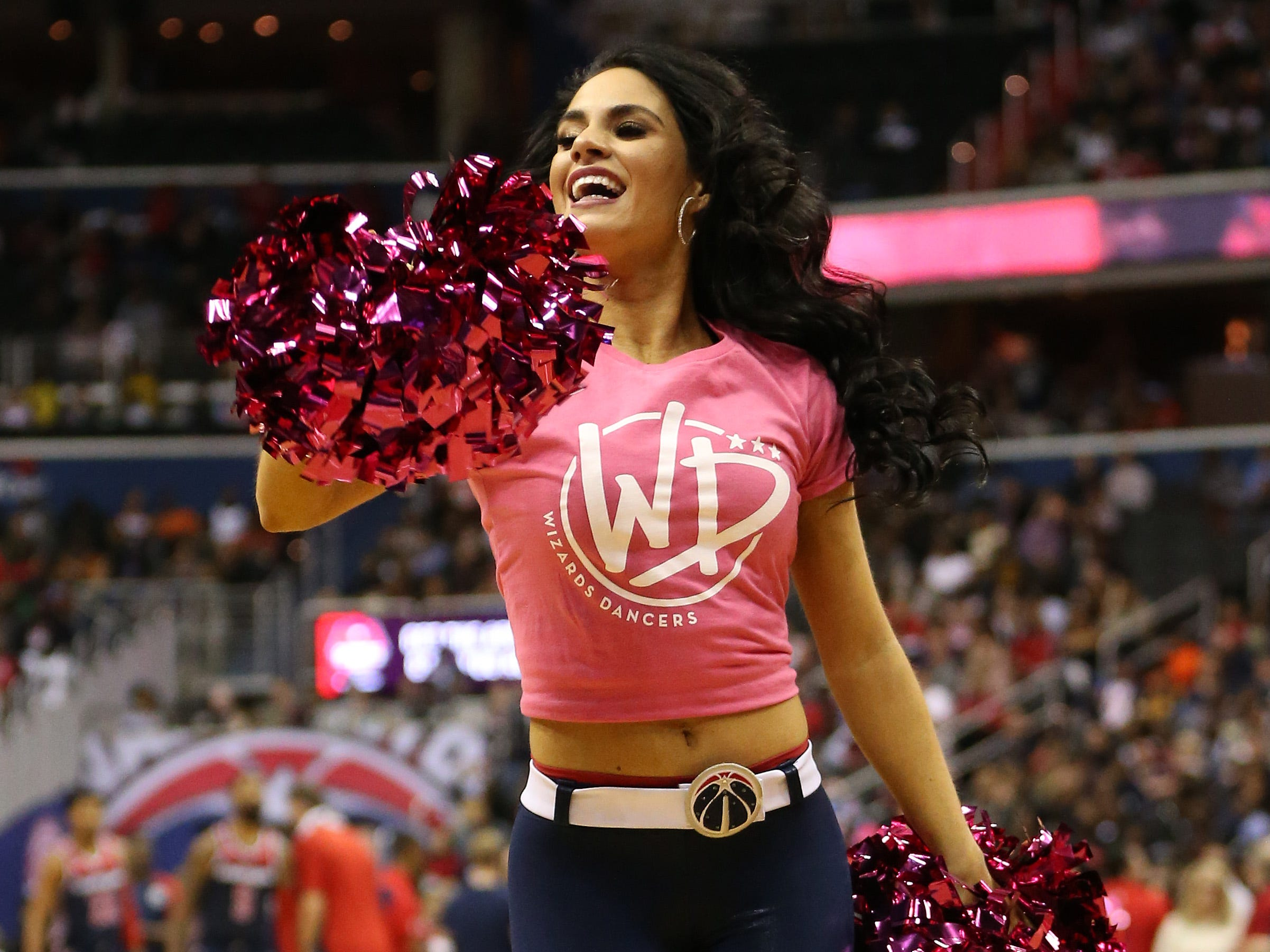 Oct. 20: A member of the Washington Wizards dance team dances on the court during a timeout against the Toronto Raptors in the fourth quarter at Capital One Arena.