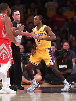 Lakers guard Rajon Rondo (right) throws a punch at Rockets guard Chris Paul as a fight broke out in the fourth quarter of the game at Staples Center.