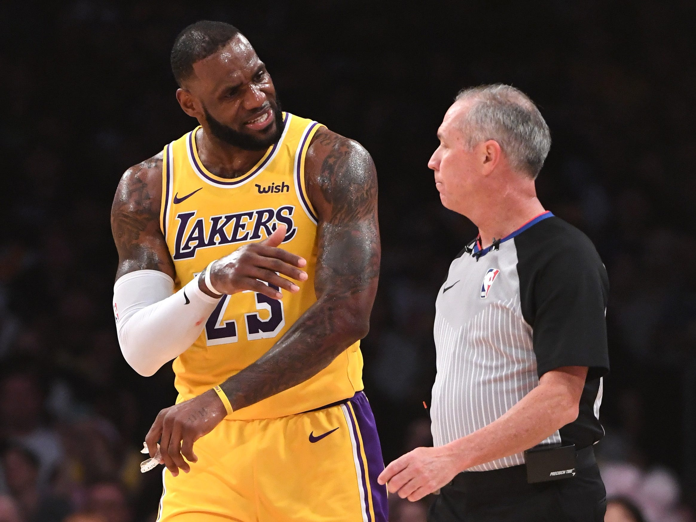 James pleads his case with referee Jason Phillips during the Lakers' home opener.