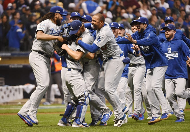 Dodgers players celebrate the finalk out.