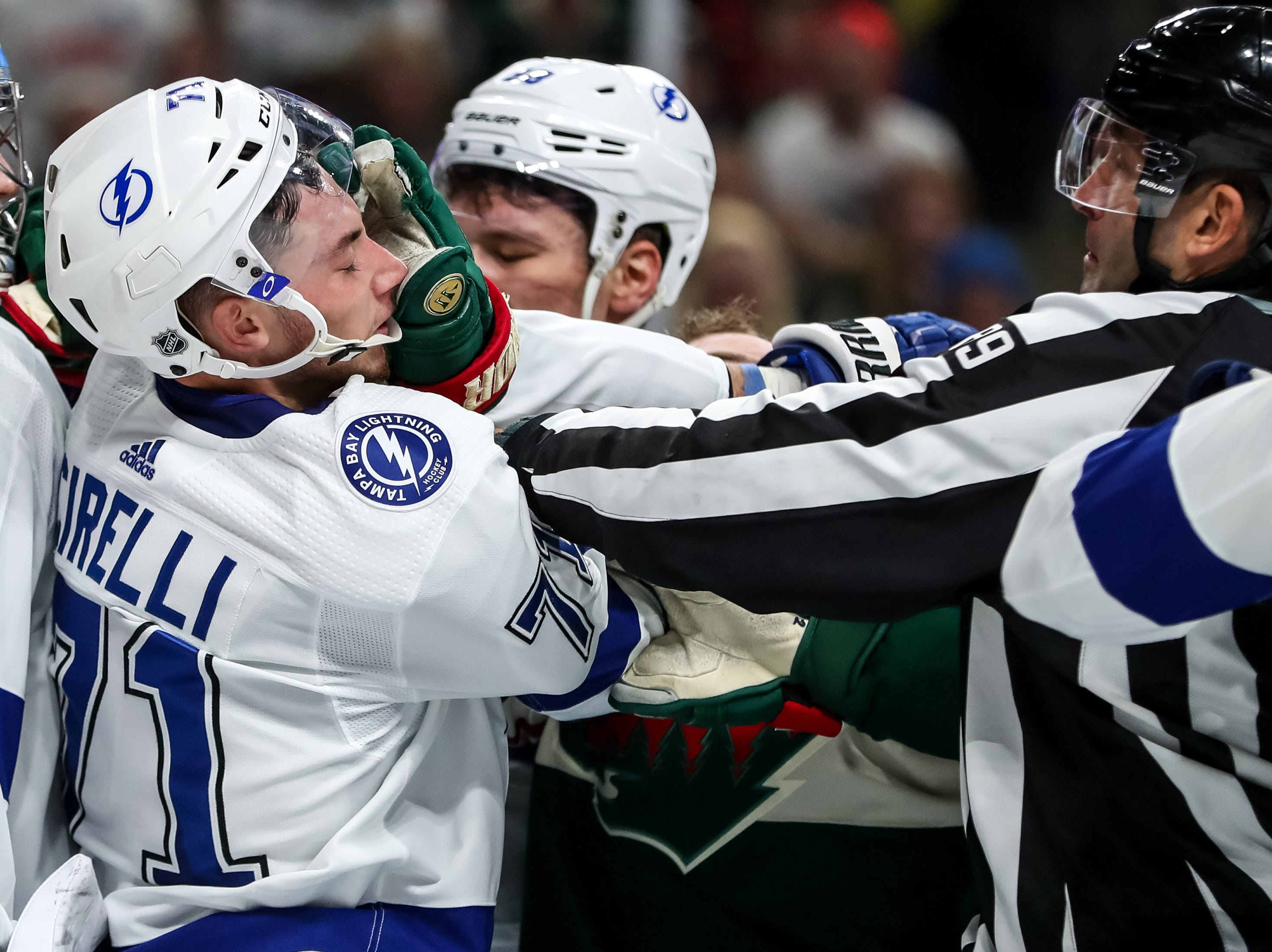 Oct. 20: Tampa Bay Lightning forward Anthony Cirelli (71) takes a hand to the face from Minnesota Wild forward Jason Zucker (16) during the second period at Xcel Energy Center.