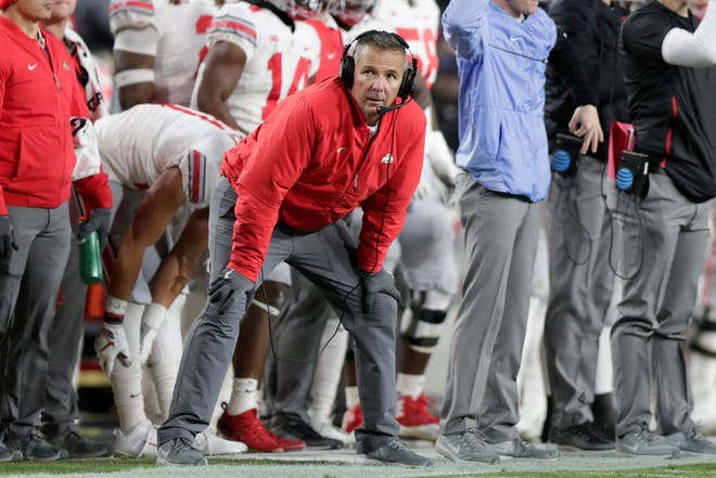Ohio State head coach Urban Meyer watches from he sideline during the first half against Purdue.