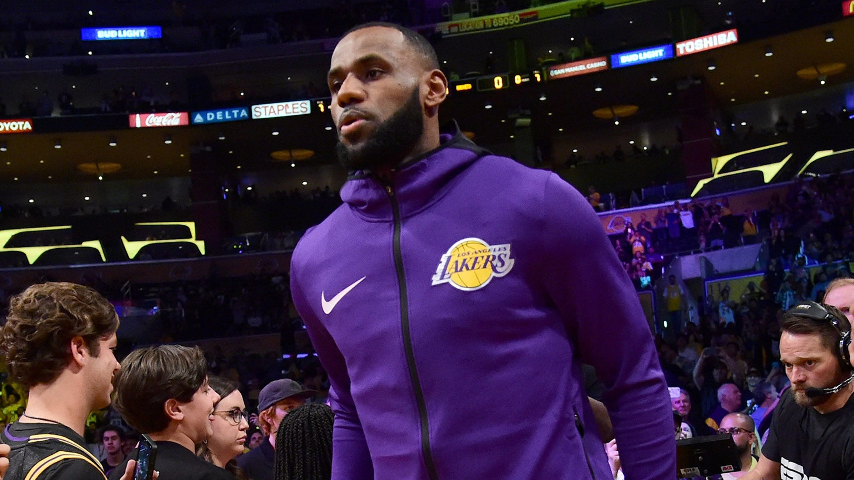841cbfe7d85 LeBron James the brightest star among stars at Lakers home debut